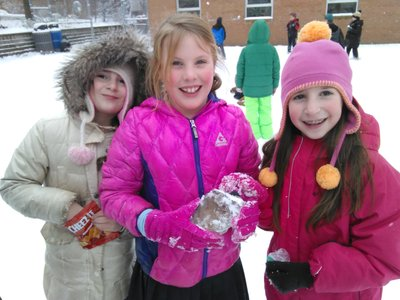 Hillel Academy third-graders enjoy the first real snow of the season during a recent recess.Photo provided by Hillel Academy