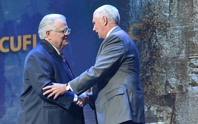 Pastor John Hagee, founder of Christians United for Israel, shakes hands with Vice President Mike Pence at CUFI's annual conference in July.  (Photo by Kasim Hafeez/CUFI)