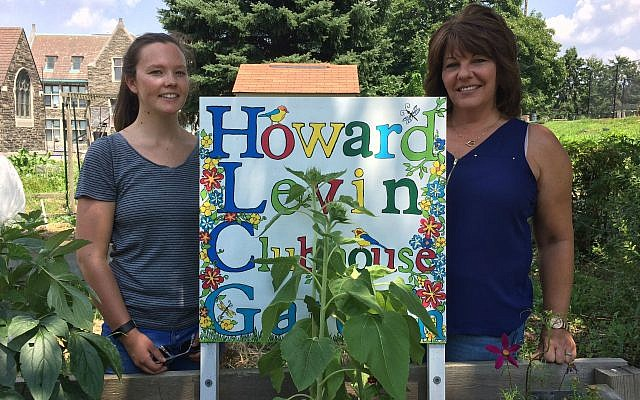 Emily Kramer (left) and Jill Pawlowski help tend the Clubhouse garden. (Photo by Toby Tabachnick)