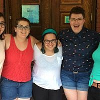 Moishe House is a network of some 58 houses scattered throughout the United States offering programs geared to Jewish millennials. Pictured, Pittsburgh residents Becca Michelson, Rose Eilenberg, Jessica Savitz, Carly Chernomorets and Dafna Bliss are all smiles as they pose for a photo. (Photo by Toby Tabachnick)