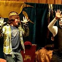 Ofer Goren (right) performs a scene from his Purim spiel with Blake Humphrey of Temple Shalom. (Photo by Lee Chottiner)