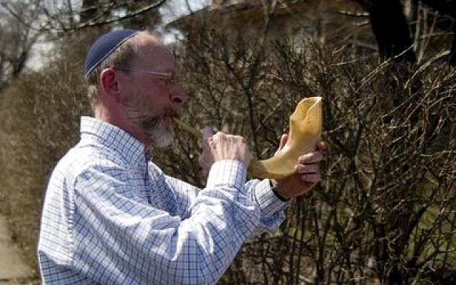 Dan Leger blew a shofar when Dor Hadash's Torahs were walked to the Tree of Life building back in 2010. (Photo by Christopher Rolinson)