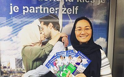 Shirin Musa hands out fliers in Rotterdam featuring images from the poster campaign on free choice of partners. (Photo courtesy of Femme for Freedom)