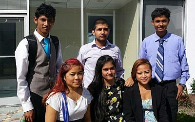 A group of high school students who participate in the JF&CS refugee youth employment program pose for a photo.  Photo provided by Jordan Golin