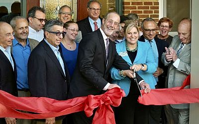 From left: Former JAA board chair Steve Halpern; Dr. John Zeisel; JAA board members Andy Stewart, Norman Childs, Todd Rosenfeld, Katie Whitlatch and Mike Levin; JAA board chair Mitchell Pakler; JAA board member Philip Lehman; City Councilman Corey O'Connor; JAA president and CEO Deborah Winn-Horvitz; president & CEO of the Jewish Federation of Greater Pittsburgh Jeff Finkelstein; community member Sally Noll; and board member Elliott Oshry  Photo by Sanford Riemer