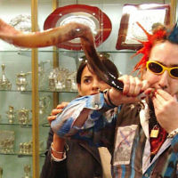 Bram Presser of the band Yidcore blows a shofar at a Judaica store in Melbourne, Australia. 	 Photo by Peter Haskin