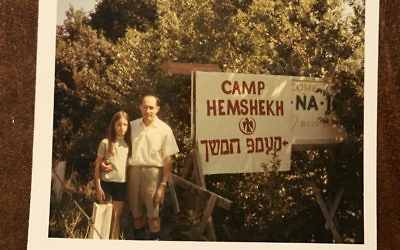 Helane Linzer and her father pose for a photoin 1969 in Mountaindale, N.Y., with the camp's new sign.	Photo courtesy of Helane Linzer