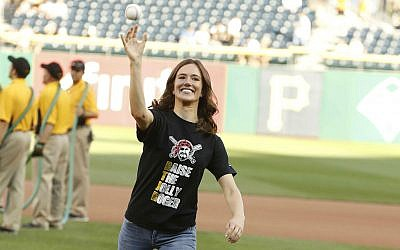 At Jewish Heritage Night at PNC Park on Aug. 8, the first pitch was thrown by Sheila Snyder; Adam Snyder was the catcher.   Photo by Dave Arrigo