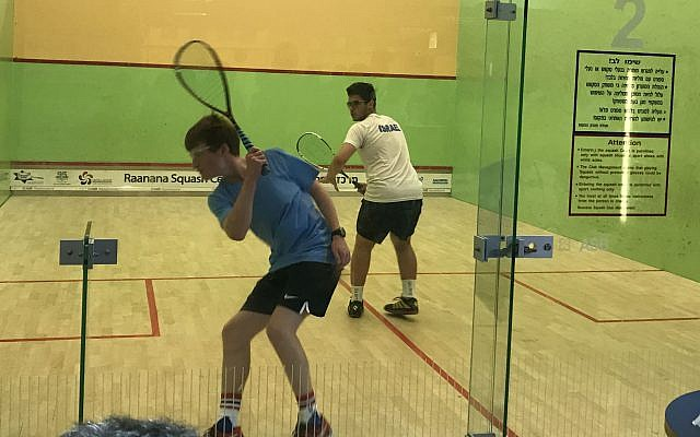 Squash team member Nathan Feinstein, left, competes in a junior boys' match at the Maccabiah Games in Israel.  Photo courtesy of Stefani Pashman