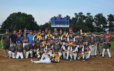 Players pose for a photo after an exhibition game between members of the Perth Heat Colts and the all-stars of Squirrel Hill baseball teams.	    Photo by Adam Reinherz