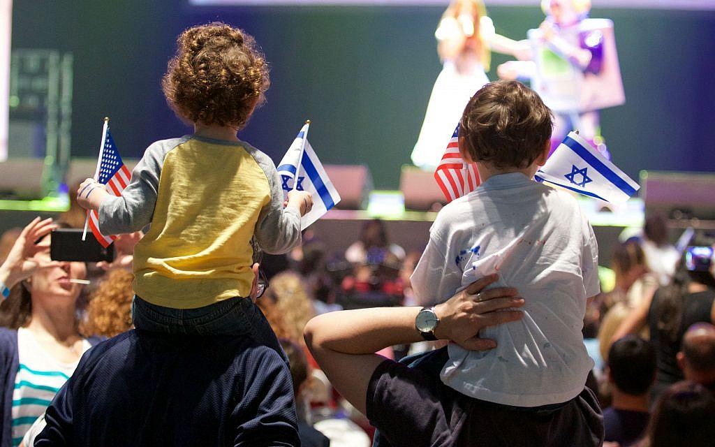 Children wave Israeli and American flags at the Celebrate Israel Parade in New York City.   Photo by Perry Bindelglass