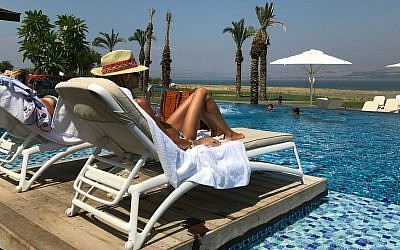 A woman sunbathes at the Setai hotel on the shore of the Sea of Galilee in Israel. 	   Photo by Andrew Tobin