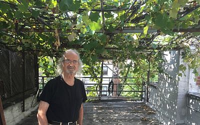 Latif Jiji poses for a photo at his Upper East Side winery, which dates back 40 years.	    Photo by David Klein