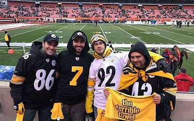 Elan Sokol, right, is joined by fellow Pittsburgh Steelers fans during a recent game.    Photo courtesy of Elan Sokol