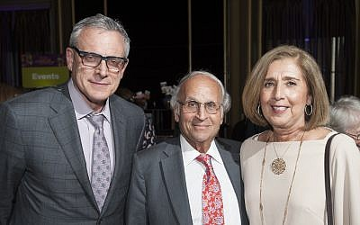 Dr. Steven D. Shapiro (left), UPMC chief medical and scientific officer, joins Grand Champion Dr. Arthur S. Levine, senior vice chancellor for Pitt's health sciences, and his wife, Linda Melada. (Photo courtesy of UPMC)