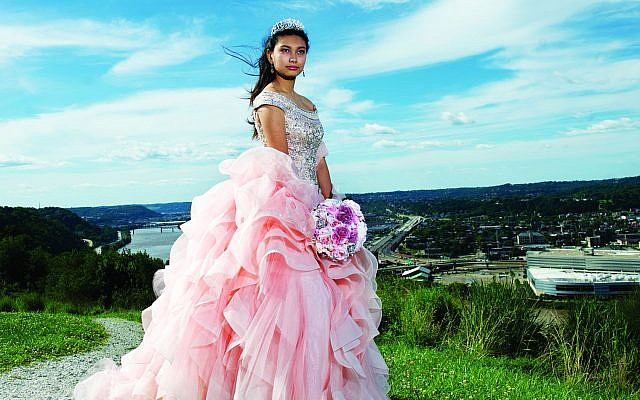 "A photo from the exhibit with the caption: ""Helen's Quinceañera, Mount Washington, 2017. Quinceañera is an important Latin American coming of age on a girl's 15th birthday. (Photo by Nate Guidry)"