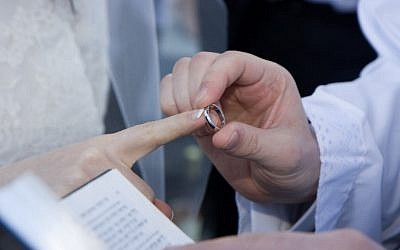 A letter from Conservative movement leaders urges rabbis to welcome interfaith couples but reiterates a ban on them performing their weddings. (Photo by Justin Oberman/ Creative Commons).