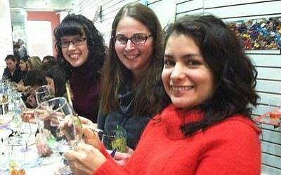 Wineglass painting, hosted by Hadassah's Zohar group, seems to agree with these young women.     Photo provided by Hadassah Greater Pittsburgh