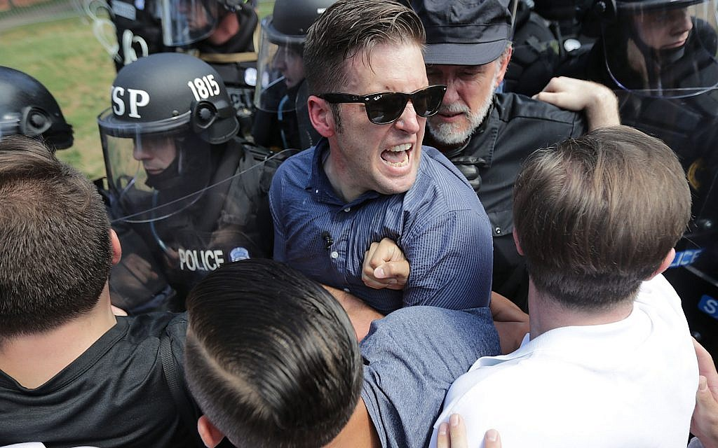 "White supremacist leader Richard Spencer, center, and supporters clash with police after the ""Unite the Right"" rally in Charlottesville, Va., in August 2017.  (Photo by Chip Somodevilla/ Getty Images)"
