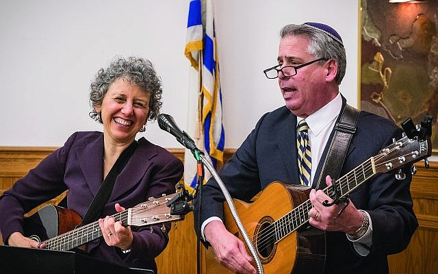 Special guest Cantor Benjie Ellen Schiller and Rabbi Jamie Gibson sing at the Shabbat dinner on Friday, Nov. 3 to celebrate the kickoff of Rabbi Gibson's 30th year at Temple Sinai. (Photo by John Schiller)