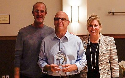From left: JAA board chair Mitchell Pakler with Employee of the Year Mark Pastoria, director of business development, and president and CEO Deborah Winn-Horvitz. (Photo courtesy of Jewish Association on Aging)