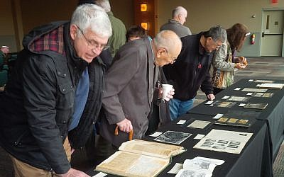 Onlookers observe World War I related materials during the Nov. 12 program at the Heinz History Center. (Photo by Adam Reinherz)