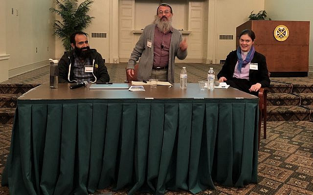 Settler Rabbi Hanan Schlesinger (center) and Palestinian Christian Antwan Saca address an audience including Presbyterians and Jews at the Pittsburgh Theological Seminary. The Rev. Liddy Barlow (right) moderated the event. (Photo by Jim Busis from the Pittsburgh Jewish Chronicle)