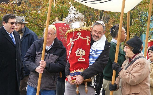 Members of New Light Congregation proudly carry six Torah scrolls to their new home at Tree of Life*Or L'Simcha. (Photo by Barry Werber)