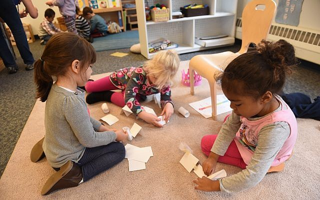 Prekindergarten learners from the Jewish Community Center of Greater Pittsburgh's Early Childhood Development Center create paper structures, just one of many STEM projects incorporated into their curriculum. (Photos courtesy of Matt Unger for the Jewish Community Center of Greater Pittsburgh)
