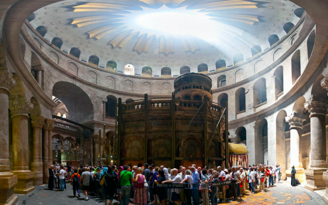 Visitors line up at the Tomb of Christ at the Church of the Holy Sepulchre in Jerusalem. (Photo by Michael Privorotsky/Flickr)