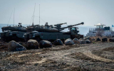 IDF soldiers at the Israeli-Syrian border in the Golan Heights. (Photo by Basel Awidat/Flash90)