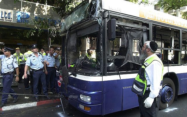 Israeli police and aid workers search the scene of a suicide bomb attack on a bus in Tel Aviv.	(Photo by Rahanan Cohen/IDF/Getty Images)