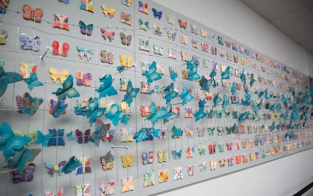 The mosaic project includes five panels, mesh fencing and more than 300 hand-painted butterflies. (Photo by Alix Paul)