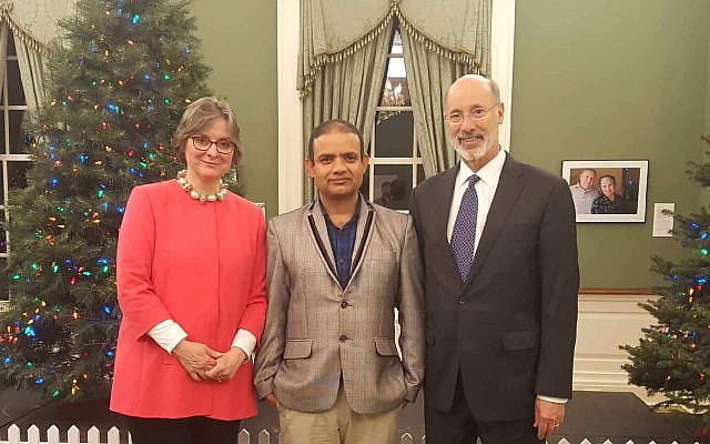 Jewish Family and Community Services Refugee & Immigrant service coordinator and bilingual navigator Rup Pokharel poses with Gov. Tom Wolf and Frances Wolf. (Photo courtesy of Jewish Family and Community Services)