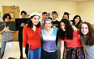 HaZamir Pittsburgh teens pose for a photo during one of their weekly rehearsals. Back row, from left: Zev Haworth, Max Rosen, Joey Breslau, Eitan Weinkle, Yael Perlman and Naomi Frim-Abrams; front row, from left: Sarah Krastman, Ada Perlman, Dana Engel and Dori Catz. (Photo courtesy of Molly D. May)