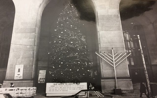 A photo exhibit of the menorah and Christmas tree on the steps of the City-County Building admitted at the trial (Photo by Toby Tabachnick)