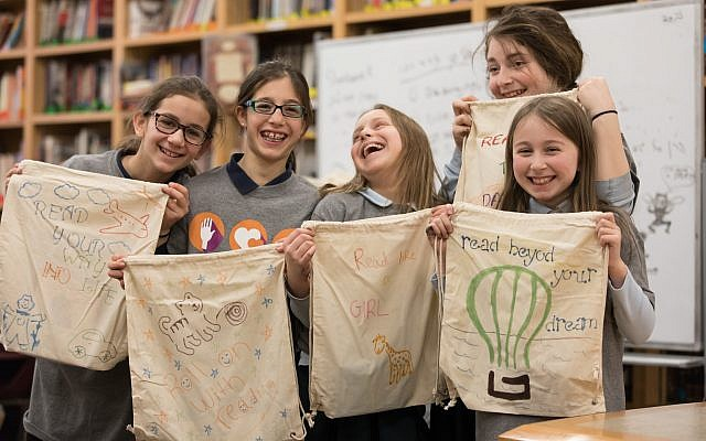 Hillel Academy, Squirrel Hill, hosted a Jewish Federation Volunteer Center Mitzvah Day team that assembled literacy kits for children served by United Way programs. (Photo by Josh Franzos)