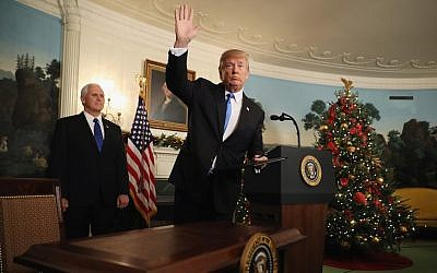 Donald Trump waving to reporters, as Vice President Mike Pence looks on, after announcing that the U.S. government will formally recognize Jerusalem as the capital of Israel in the Diplomatic Reception Room at the White House, Dec. 6, 2017. (Photo by Chip Somodevilla/Getty Images)