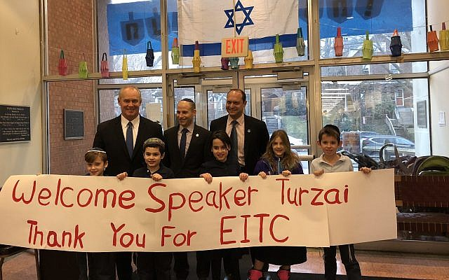 Students at Hillel Academy welcome State Rep. Mike Turzai with signs. (Photo by Lauren Rosenblatt)