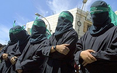 Masked Hamas militants mourning a suicide bomber at a symbolic funeral in Ramallah, March 29, 2001. (Photo by David Silverman /Newsmakers)