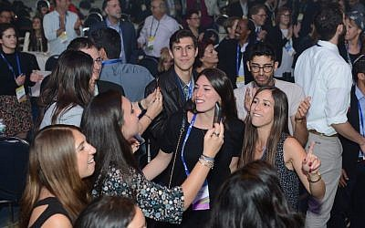 Some 3,000 people attendees celebrate their dual identities at the Israeli-American Council's annual convention in Washington, D.C., November 2017. (Photo by Peter Halmagyi)