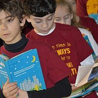 These students at Community Day School are participating in a morning tefillah or prayer service. (Photo courtesy of Community Day School)