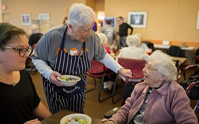 At Riverview Towers in Squirrel Hill, a salad served was an opportunity for human connection between a Jewish Federation Volunteer Center volunteer and a Riverview resident. (Photo by Josh Franzos)