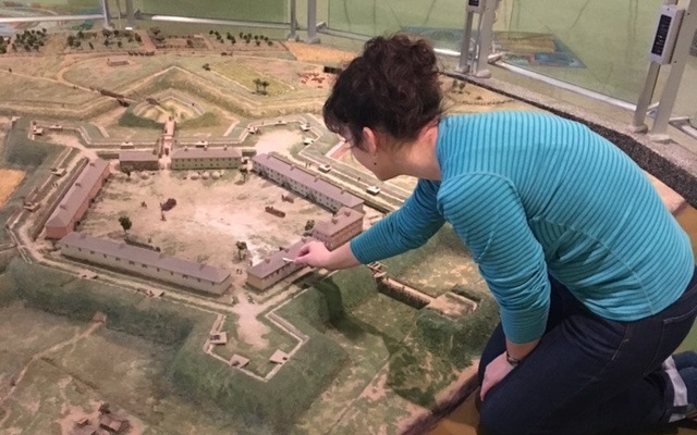 A museum staffer cleans the Fort Pitt diorama. (Photo courtesy of the Fort Pitt Museum)
