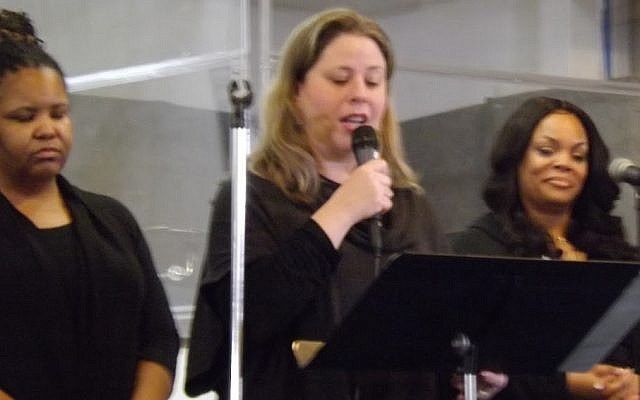 Cantorial soloist Sarah Stock Mayo, center, joined the Rodman Mass Choir in singing. (Photo by Barry Werber)