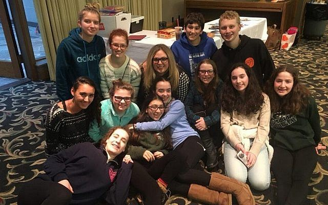 Rodef Shalom teens and fellow NFTY teens from across the region with youth group advisor Marissa Tait, center. (Photo by Jordana Avigad)