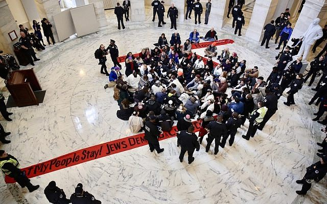 Jewish protesters link arms in a Senate office building asking for protections for undocumented immigrants who arrived as children, Jan. 17 2018. (Photo courtesy of Religious Action Center of Reform Judaism)