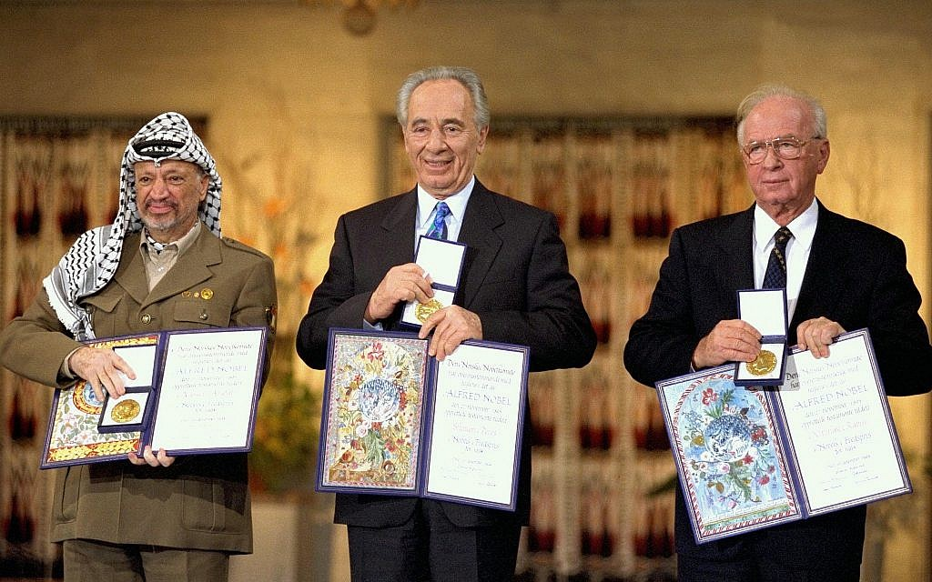 From left: Yasser Arafat, Shimon Peres and Yitzhak Rabin after receiving the Nobel Peace Prize in 1994. (Photo courtesy of Wikimedia Commons)