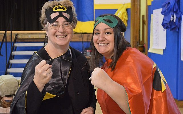 CDS first-grade teachers (and real-life superheroes) Amy Matthews, left, and Elizabeth Halfhill. (Photo courtesy of Community Day School)