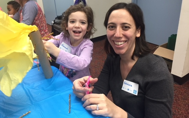Rebecca Lasus and daughter Hannah attend PJ Library's Tu B'Shevat program at the Mt. Lebanon Library. Children were asked to craft a tree out of recycled materials. (Photo courtesy of PJ Library)